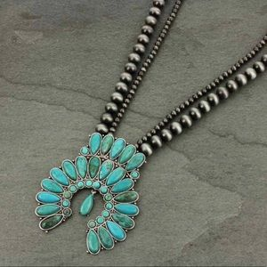 Turquoise Natural Stone Squash Blossom Necklace.